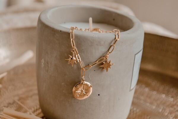 Armband kompas met schakeltjes en sterren goud
